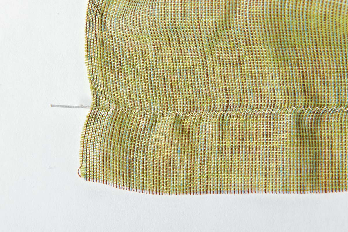 Elastics application: Couch the beading elastic to the garment.