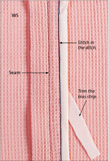 Stitch in the ditch on the seam allowance only