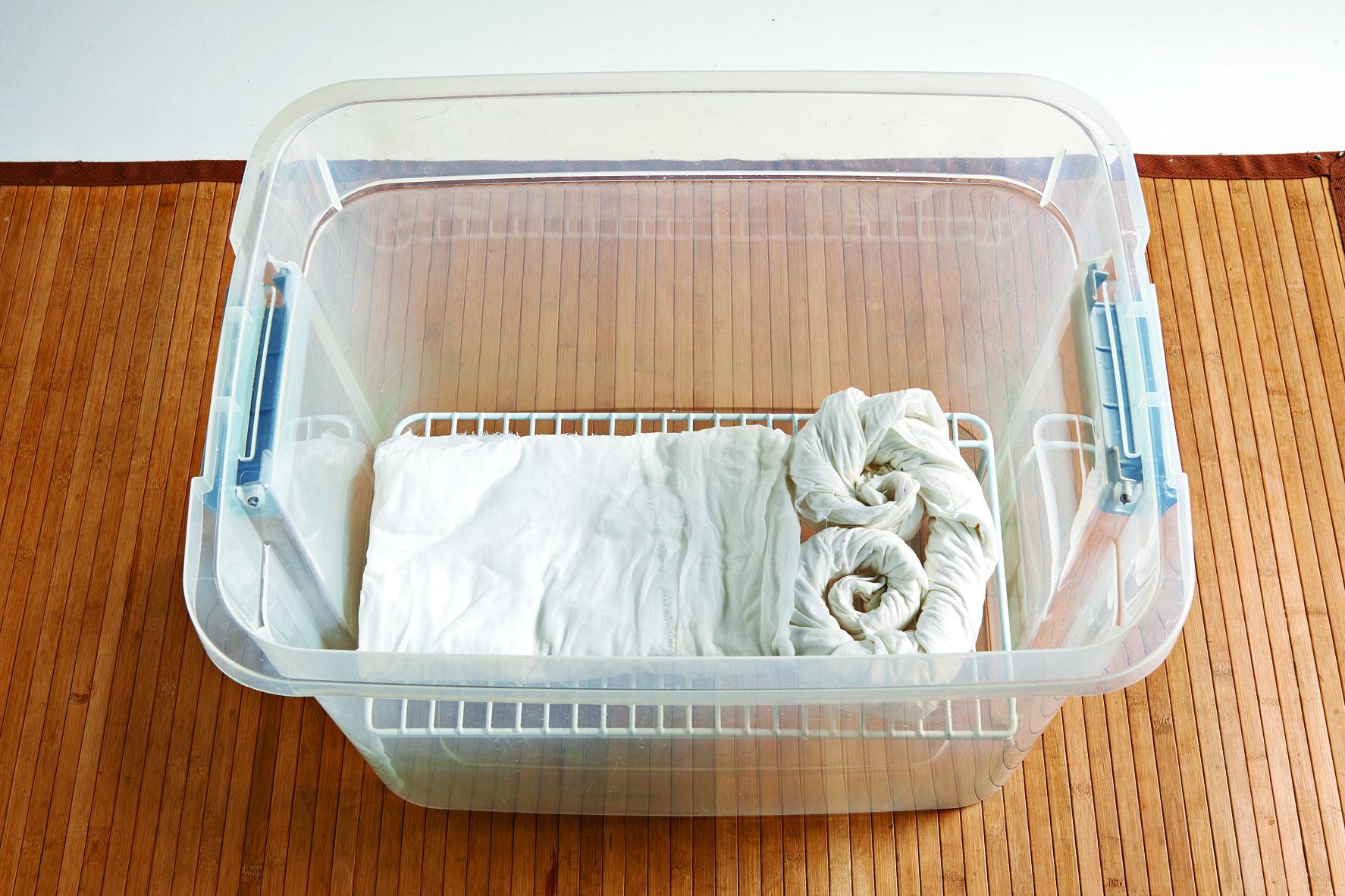 Plastic Storage bin with fabric and kitchen shelf.
