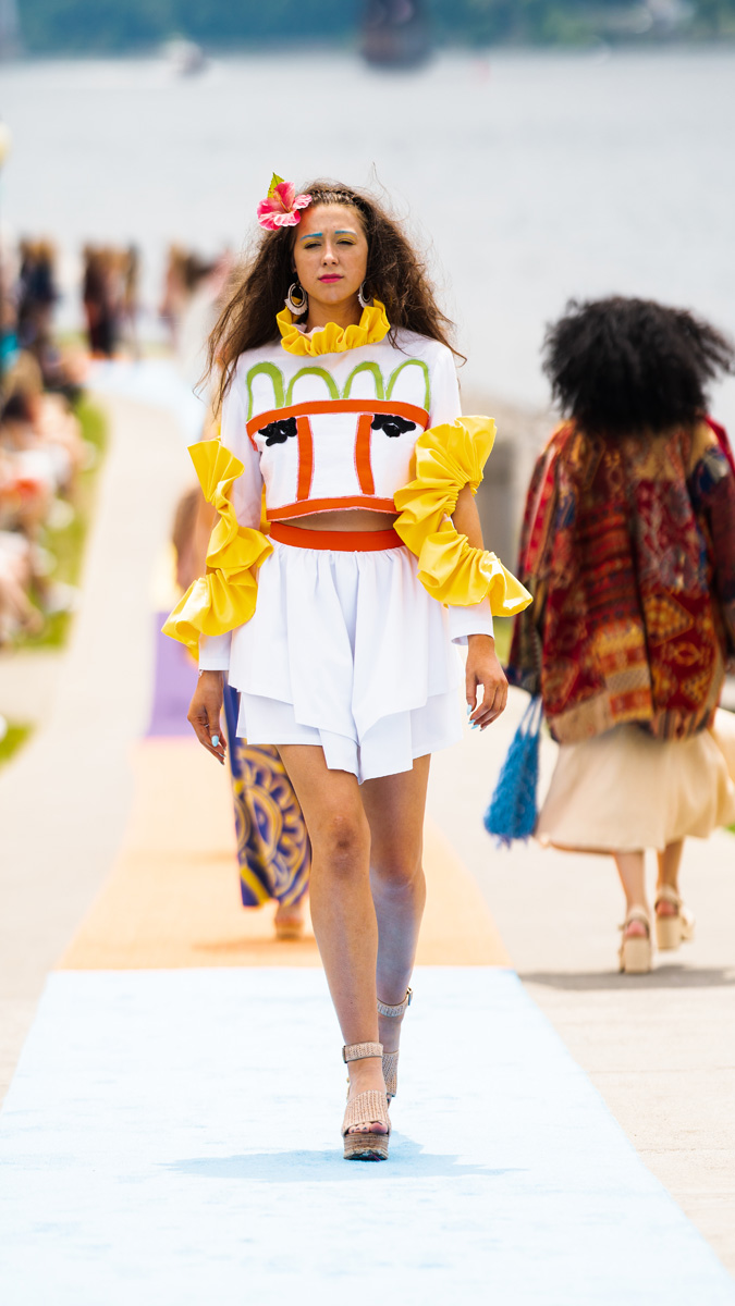 Kristine Otero design: Multilayered white miniskirt with coordinating appliqued white top with yellow ruffle-trimmed sleeve cutouts