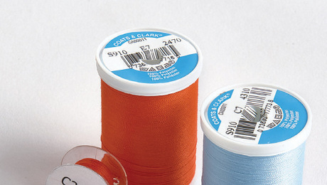 Two spools of thread with two bobbins.
