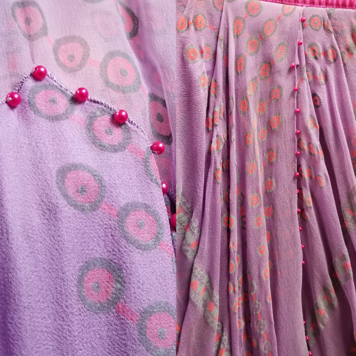 CLose-up of beads sewn at seam edges of Zandra Rhodes design
