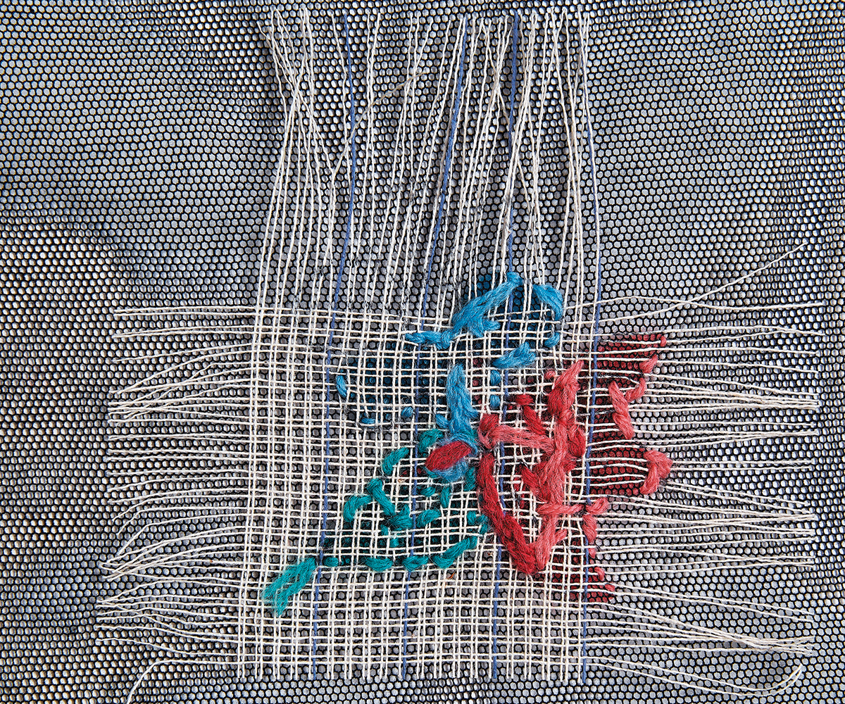 pulling out waste canvas from embroidery