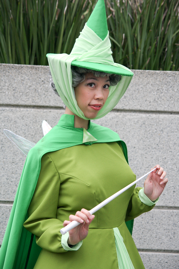 @confusedkittysewing wears a green, Disney-inspired costume.
