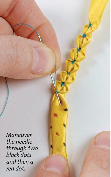 needles going through the thread