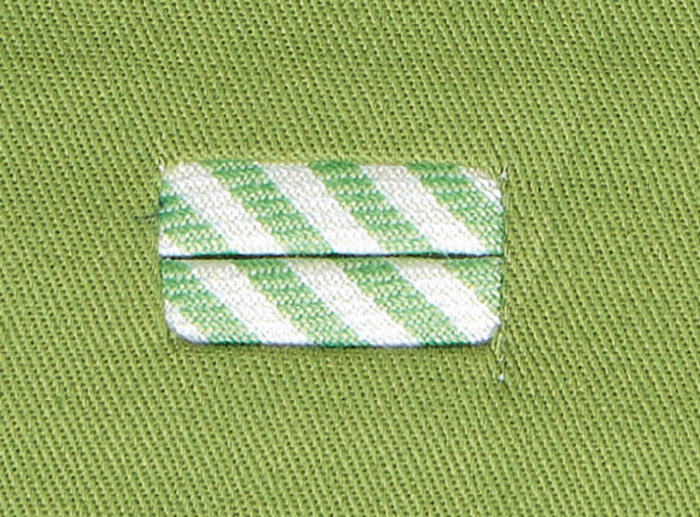 Showing the use of contrasting fabric for a bound buttonhole.