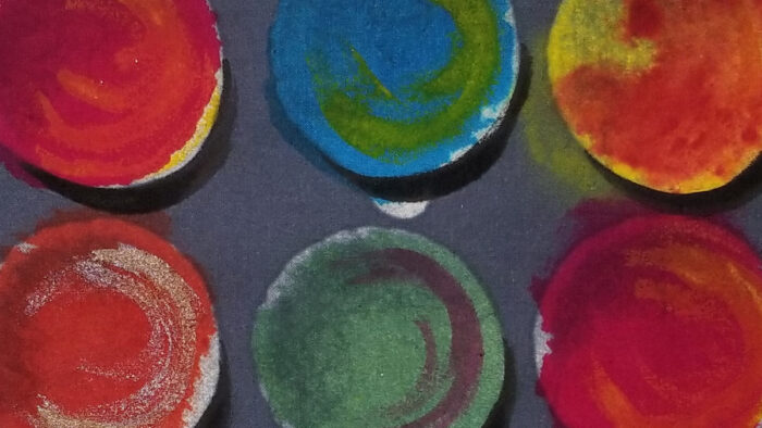 close-up of multi-colored fabric with a circle print: Gilbert Muniz's inspiration and creation