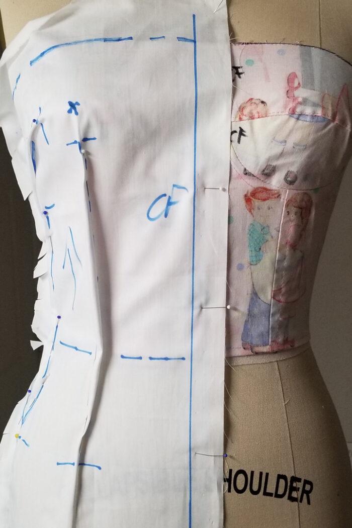 Gilbert Muniz's inspiration: his self-draped muslin on a dress form with markings