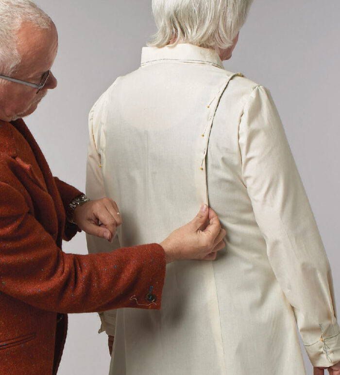 Kenneth D. King adjusts test garments on the volunteers, taking cues from the fit of their ready-to-wear clothes.