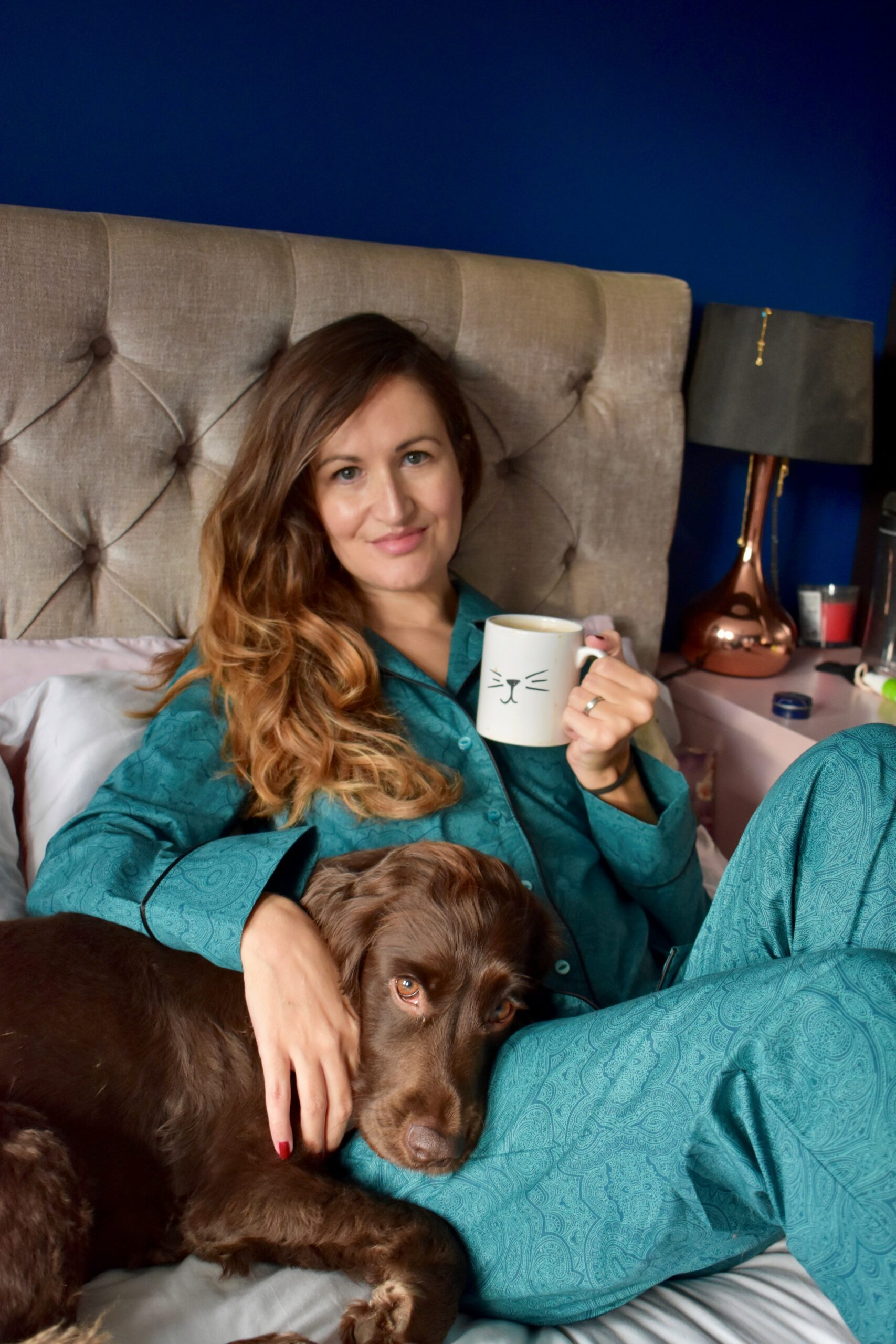 Woman relaxing on a bed in loungewear pajamas