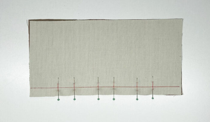 Pinned button placket extension.