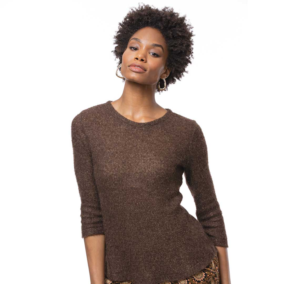 Achieve stable, ripple-free results with a soft knit by applying stay tape. Pattern: Pamela's Patterns 104 The Perfect T-Shirt. Fabric: wool-blend sweater knit.
