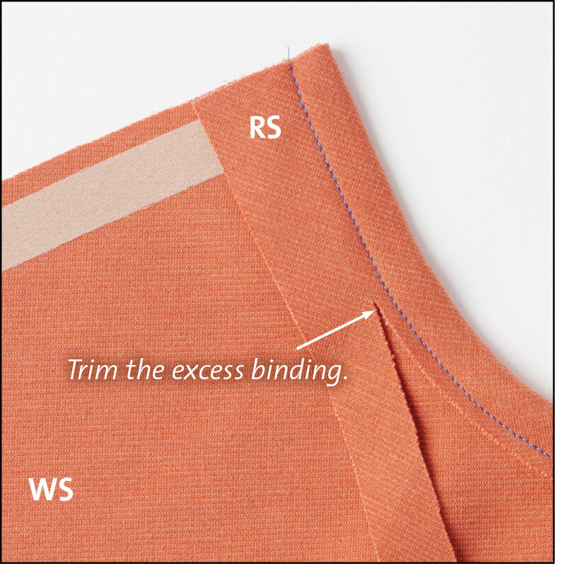 Wrap the trim over the neckline seam allowance to the wrong side.