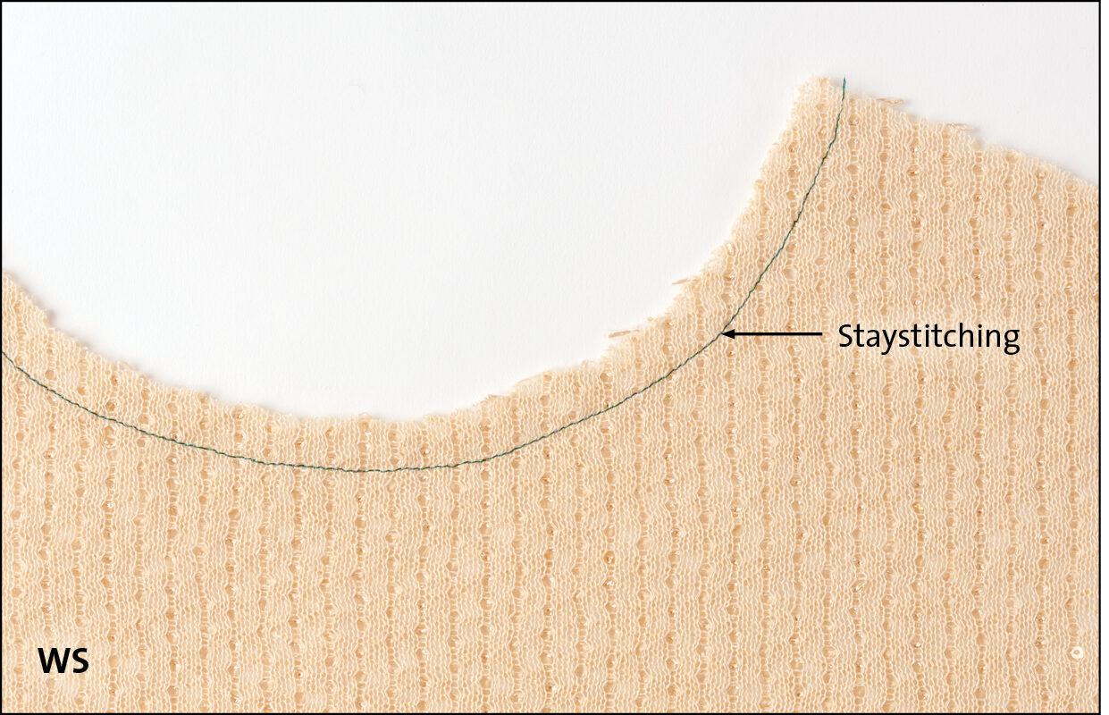 Staystitch the garment. Place the stitching about 1/2 inch from the edge.