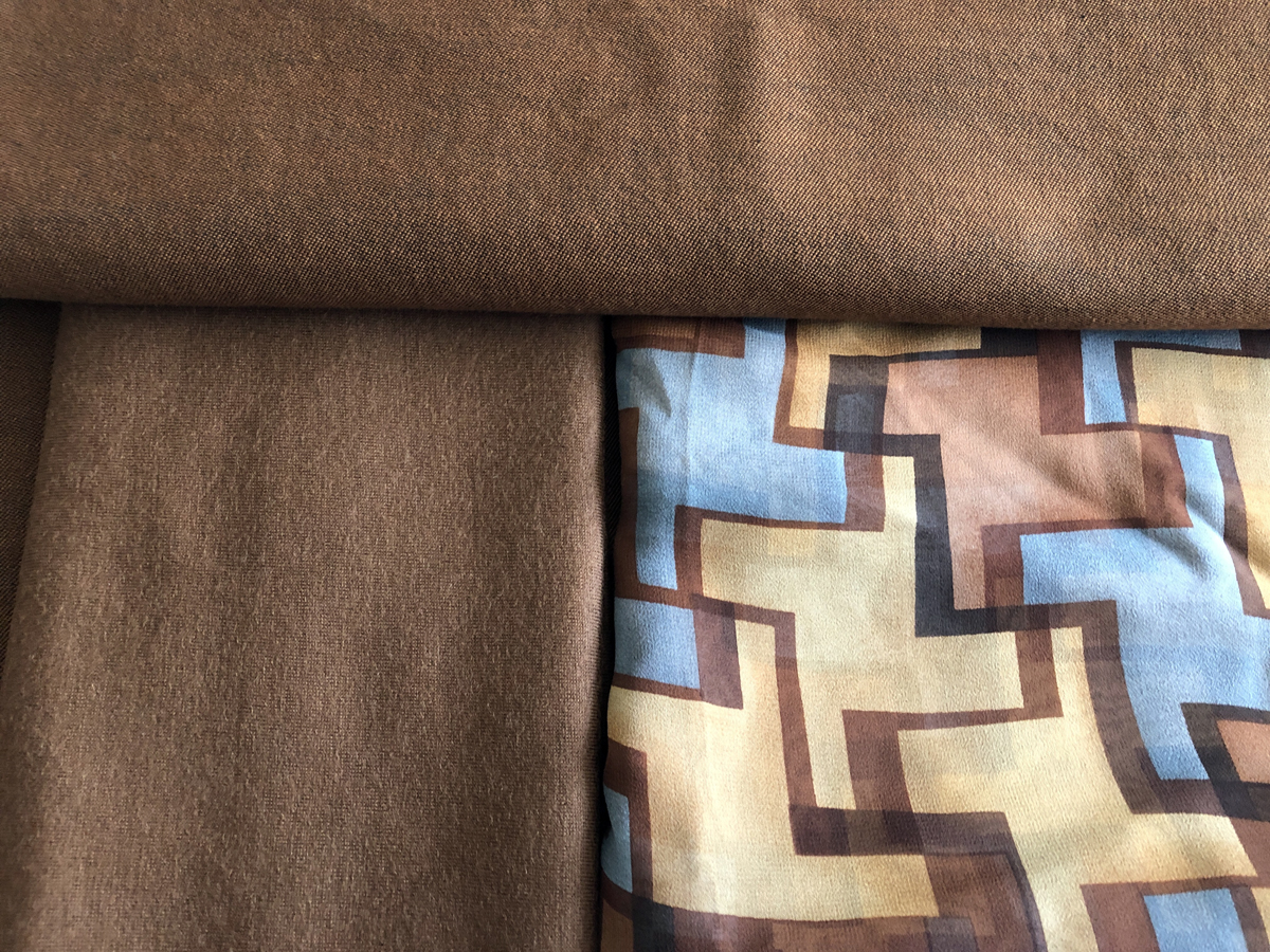 Pamela Howard's inspiration includes three fabrics: two brown and one geometric print