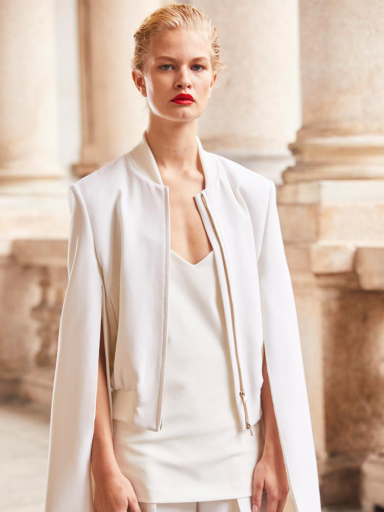 Pamela Howard's inspiration: Model wears white, zip-front Max Mara bomber jacket with two-piece sleeves.