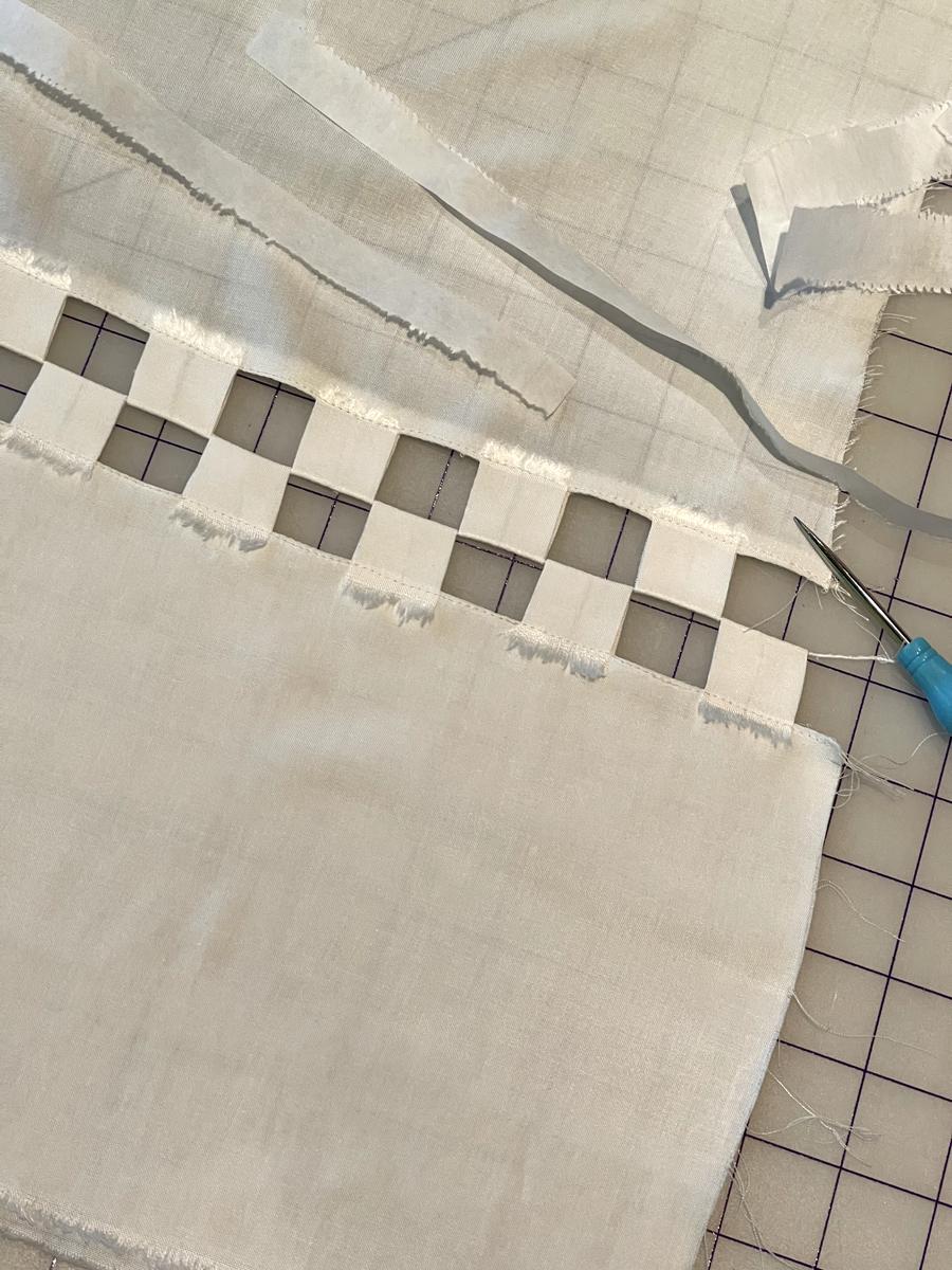 Raw edge white fabric square create a checkerboard effect