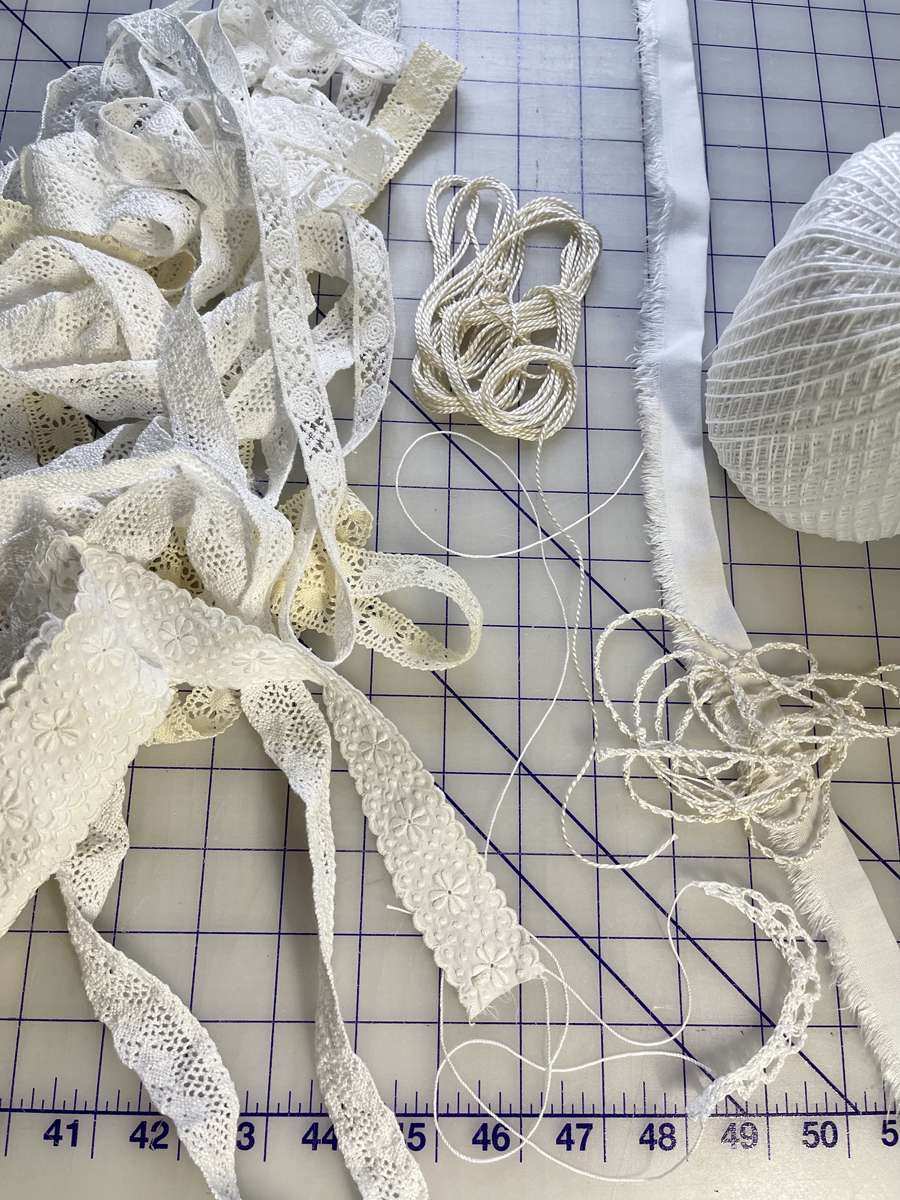 Becky Fulgoni's inspiration: Lace edgings piled on a gridded cutting mat