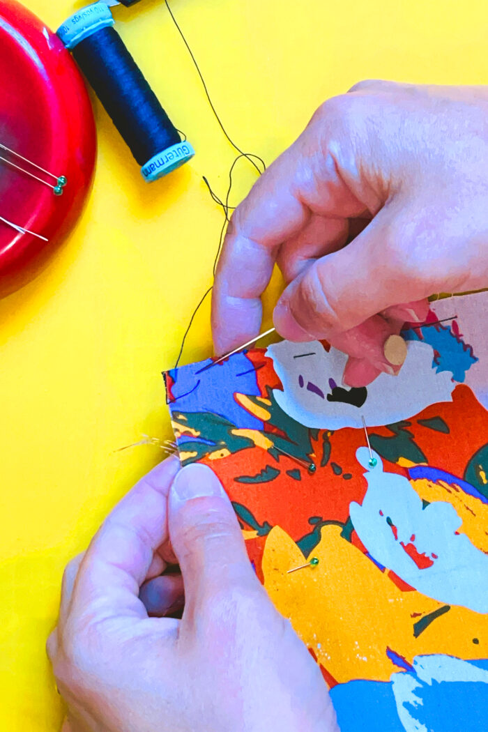 Use silk thread to baste the underlining and fashion fabric sections together.
