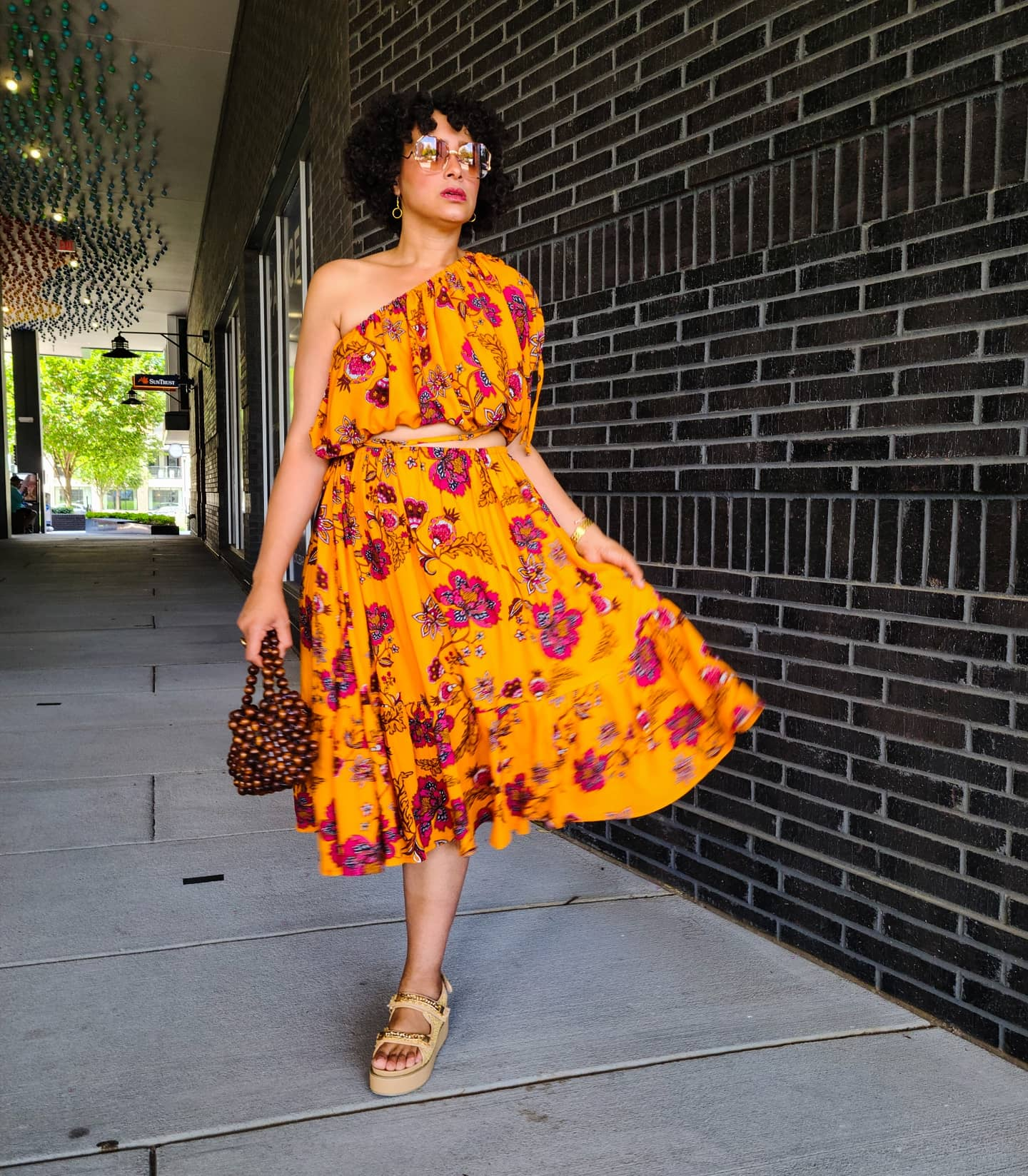Marcia Spencer @keechiibstyle in yellow print dress