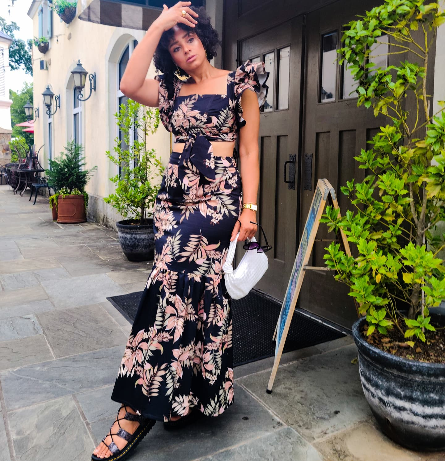 Marcia Spencer in two-piece print outfit with maxi skirt