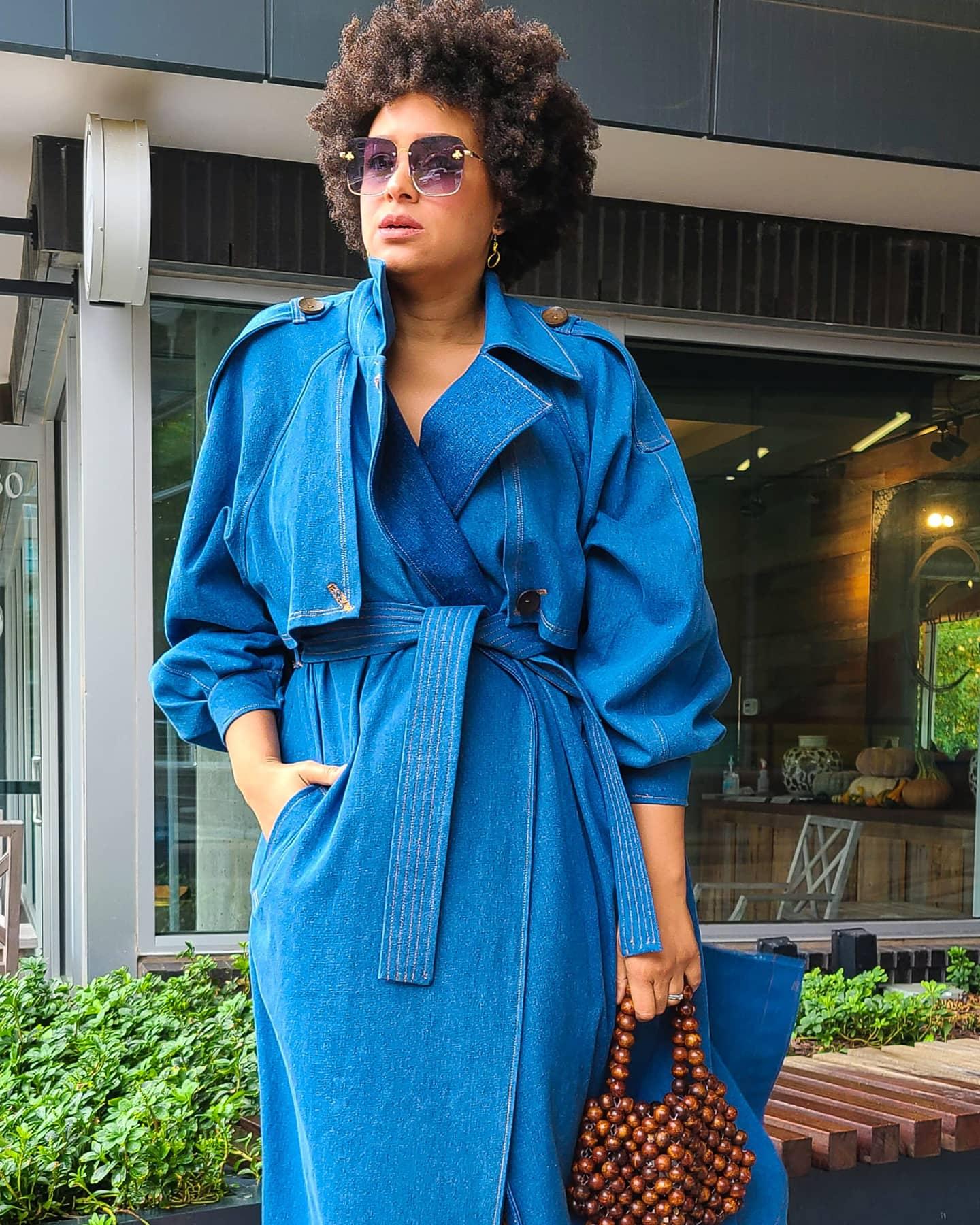 Marcia Spender in blue denim trench coat