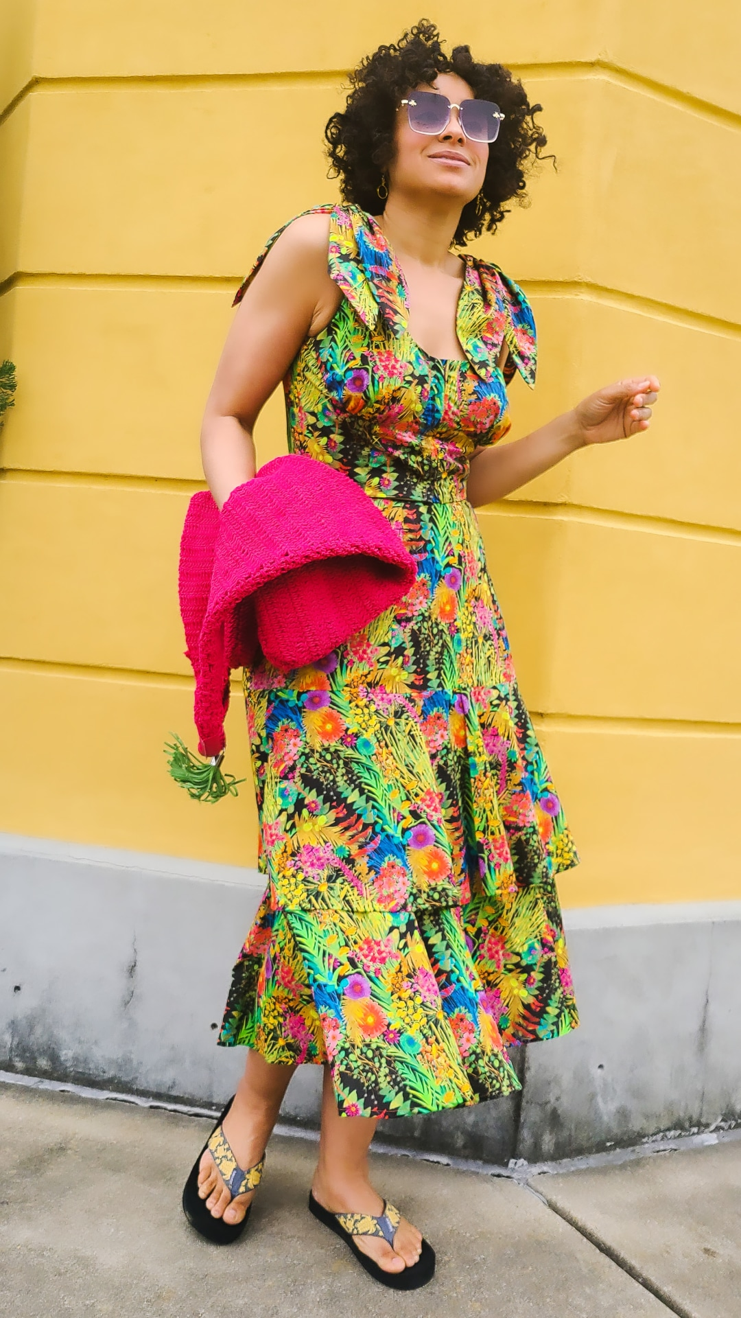Marcia Spencer @keechiibstyle in a printed dress, with hot pink accessory