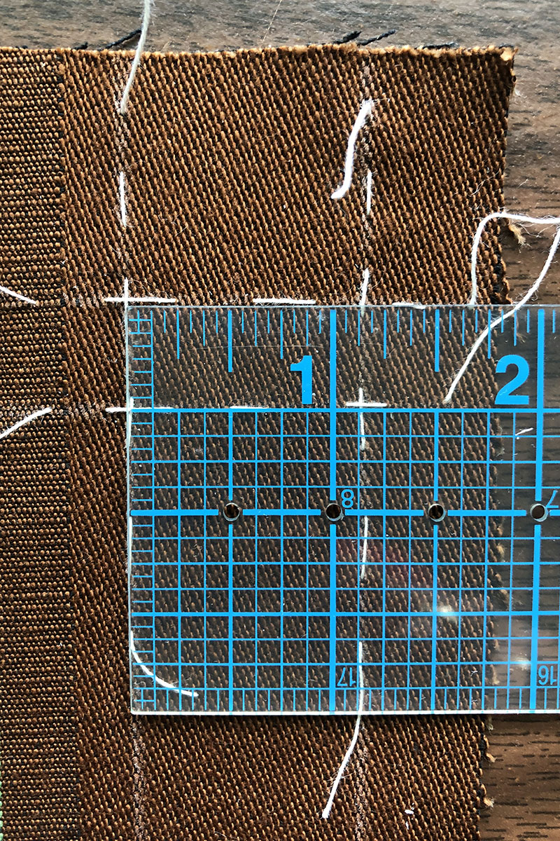 Clear ruler used to check the accuracy of markings for buttonholes