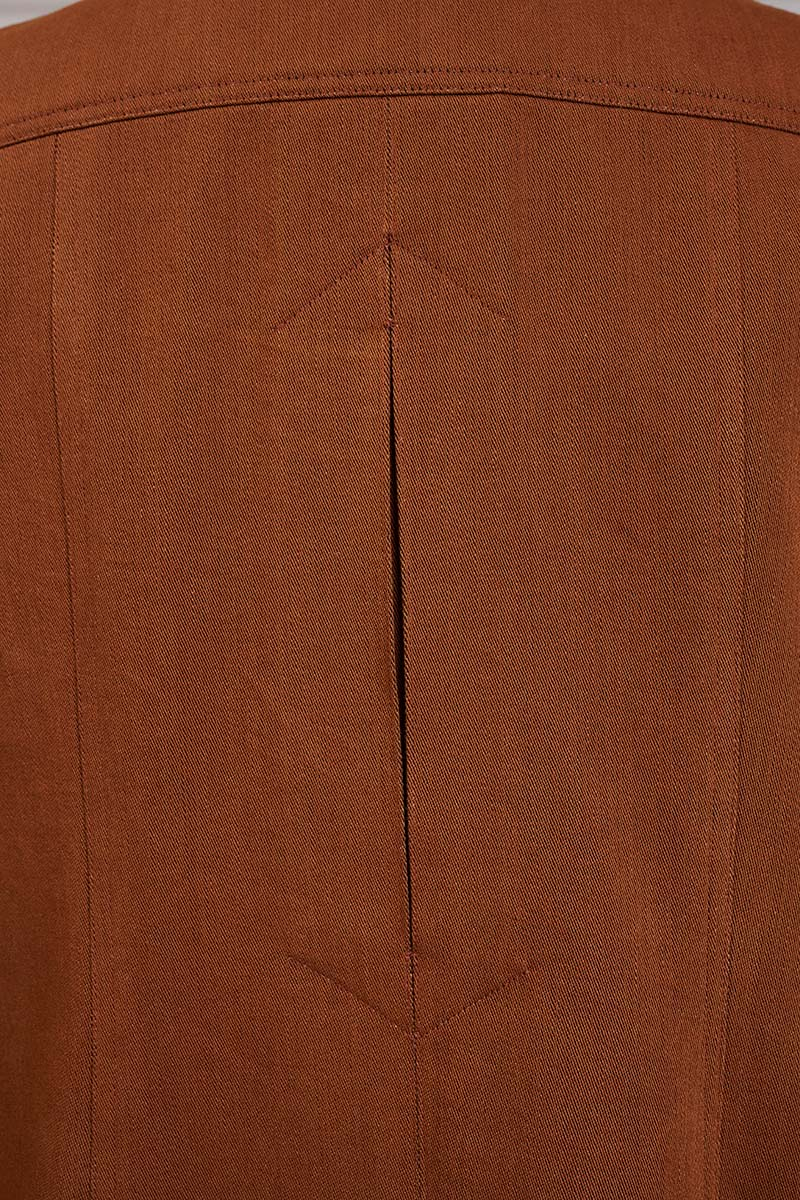 close-up of inverted and closed back pleat on center back of cape sleeve coat