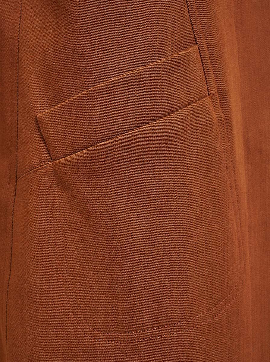 Topstitched pocket on brown denim coat
