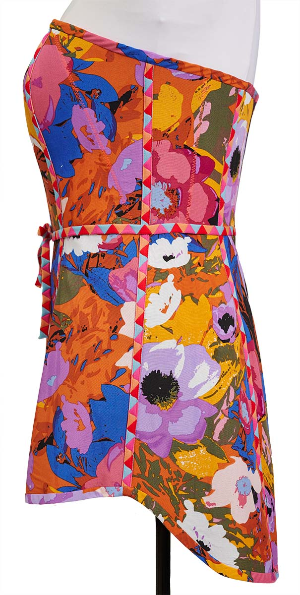 A curved hemline on technicolor minidress reflects the curved neckline
