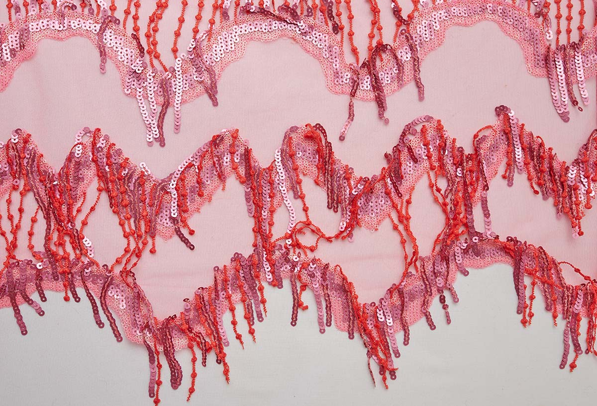 Close-up of sequined and fringed fabric
