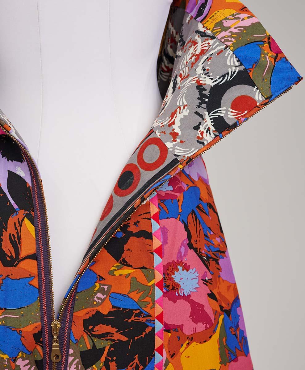 Exposed zipper partially open on the technicolor minidress
