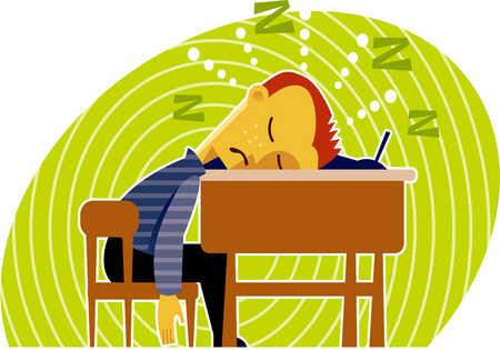 a boy sleeping at his desk