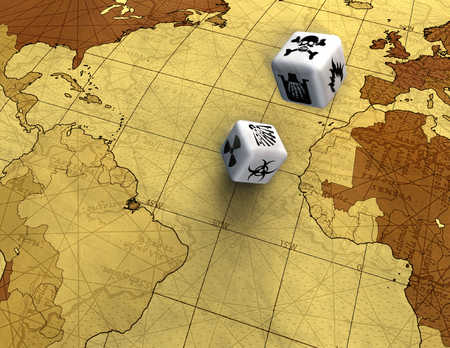 Pair of dice on world map, close-up, elevated view