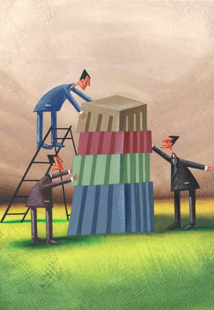 Business people with building blocks