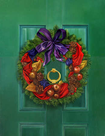 A green door with a decorative wreath