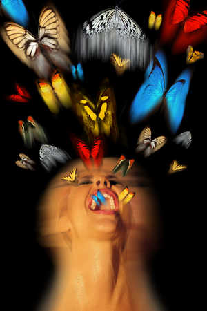 Butterflies flying out of a woman's mouth