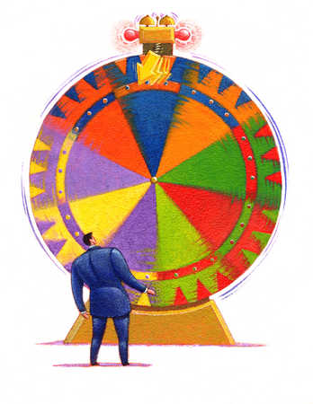 Businessman looking at spinning wheel