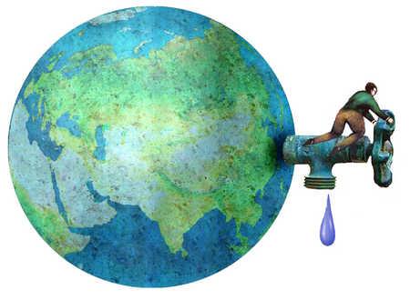 Man turning faucet on globe