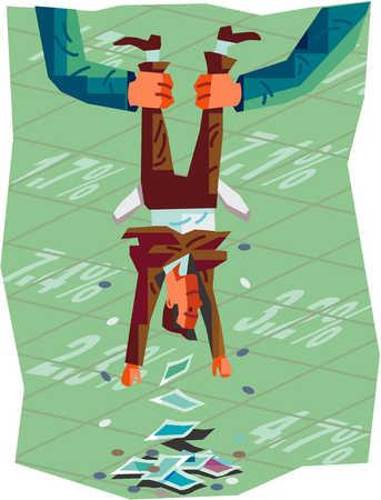 Businessman being shaken upside down to empty pockets