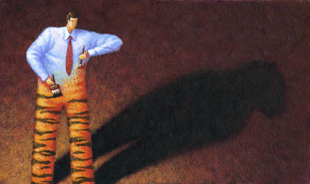 Businessman painting self as tiger
