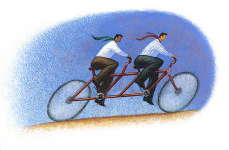 Businessmen riding tandem bicycle
