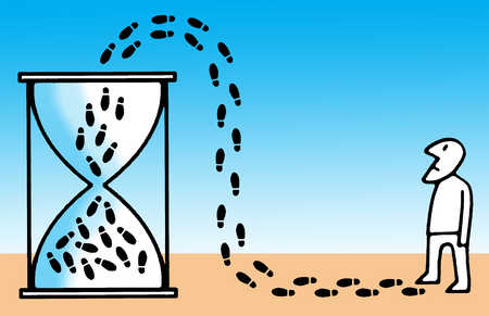 Footprints leading into hourglass