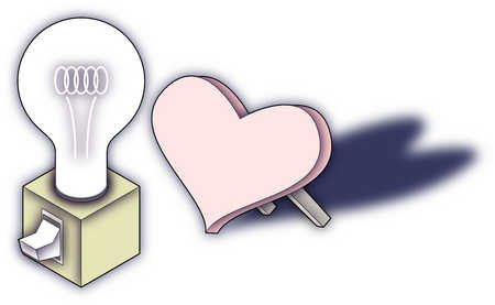Heart propped up next to light bulb