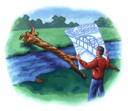 Man holding picture of bridge in front of tree over stream