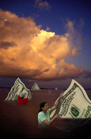 People holding large paper currency in water