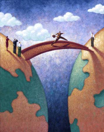 Businessman walking across bridge between globes