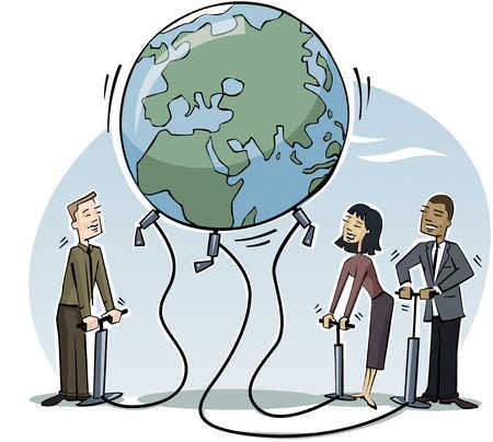 Businesspeople inflating globe