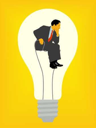 Businessman In Light Bulb